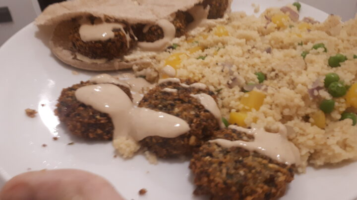 falafel, tahini sauce and pitta with cous cous